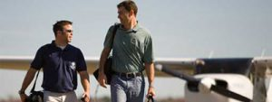 Flight Instructor and Student Walking