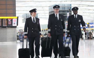 Pilots Walking in a Terminal
